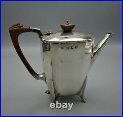 A 3-piece Sterling Silver Cooper Brothers English Art Deco Tea Set, London