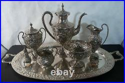 C. 1920 Kirk & Sons sterling silver Repousse tea set. 8pc without the tray